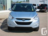 Make Hyundai Model Tucson Year 2011 Colour Blue kms