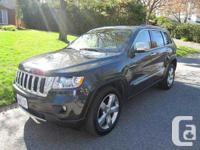 This reliable and fully loaded Jeep is in like new