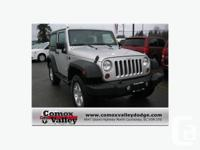 The bold 2011 Jeep Wrangler Sport SUV features tilt