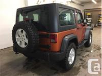 Make Jeep Model Wrangler Year 2011 Colour Mango kms