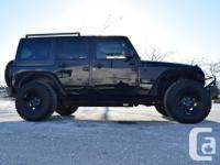 Make Jeep Model Wrangler Year 2011 Colour Black kms