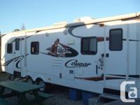 2011 Keystone Cougar 27RBS: � 32 LCD TV  � Stereo