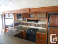 Selling our beautiful Cougar fifth wheel. This unit