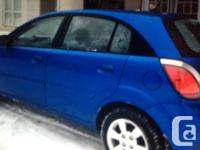 Great, dependable, blue, hatchback Kia Rio in excellent