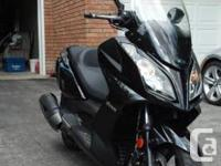 Beautiful black 2011 KYMCO Downtown 300i, Performance