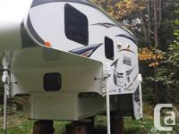 2011 Lance 950 camper for sale. It has a queen