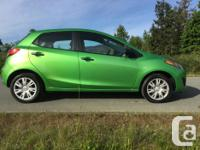 Make Mazda Model 2 Year 2011 Colour Green kms 166624