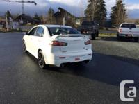 Make Mitsubishi Model Lancer Year 2011 Colour Pearl
