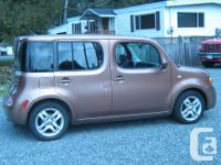 Make Nissan Model Cube Year 2011 Colour brown kms