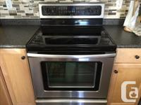 2011 Whirlpool stainless steel fridge & stove. Chip out