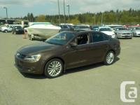 Make Volkswagen Model Jetta Year 2011 Colour Brown kms