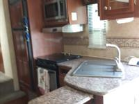 Gently used unit with rear living area, dinette slide