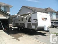 Offering a 2011 Grey Wolf 29BH trailer 3 means