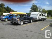 Just in time for the season! This travel trailer has