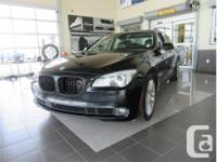 Make BMW Model 750i Year 2012 Colour Black kms 108051