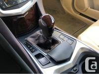 Make Cadillac Year 2012 Colour Gold Trans Automatic