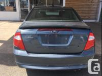 Make Ford Model Fusion Year 2012 Colour Blue kms 94527