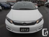 Make Honda Model Civic Year 2012 Colour Taffeta White
