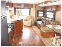 $18,500 OBO This popular rear model trailer is in