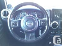 Make Jeep Model Wrangler Year 2012 Colour Black kms