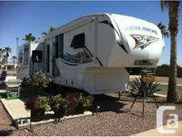 This 39FT 5th wheel sleeps 4, includes a full fridge