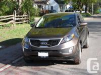 New, low mileage, 2012 Kia Sportage for sale by owner.