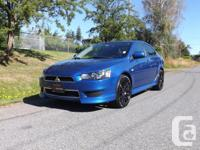 Make Mitsubishi Model Lancer Year 2012 Colour BLUE kms