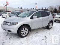 Pre-used Nissan Murano LE in white color. Stock #