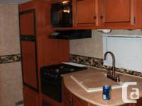 30' 2012 Athlete couples travel trailer available.