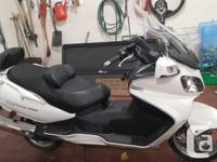 Make Suzuki Year 2012 kms 8400 White metalic Paint.