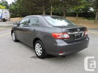 Make Toyota Model Corolla Year 2012 Colour Grey kms