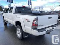 Make Toyota Model Tacoma Year 2012 Colour White kms