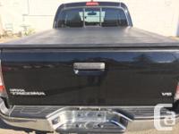 Make Toyota Model Tacoma Year 2012 Colour BLACK kms