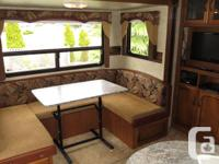 Fully loaded Rear living layout with Banquet slide out,