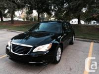 Black 2013 Chrysler 200 for sale with only 8k miles. No