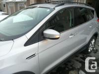 Make Ford Model Escape Year 2013 Colour grey kms