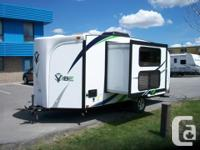 Good condition with slide, dinette, kitchen, queen bed,
