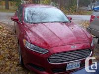 Fully loaded, low gas mileage Red 2013 Ford Fusion SE.
