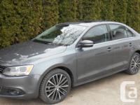 Metallic grey, 4 door, automated with all the whistles