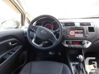 Trans Automatic This locally owned 2013 Kia Rio EX