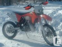 This 2013 KTM 200 XC-W comes with a pipe guard, hand