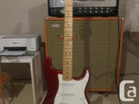 Mint condition 2013 Candy Apple Red Stratocaster. The