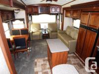 This like new 2013 Montana 3100RL 36' is great for long