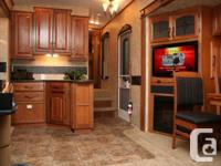 This like brand-new 2013 Montana 3100RL 36' is great