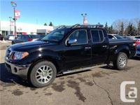 Pre-used Nissan Frontier SL crew cab in black color.