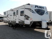 2013 Puma Travel Trailer available for sale. Sleeps as