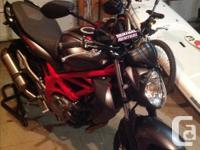 2013 Suzuki SFV 650 Gladius. Still have stock parts
