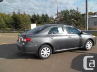 Make Toyota Model Corolla CE Year 2013 Colour GREY kms