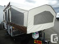 Features: Couch, bag awning, 3 burner stove, heated