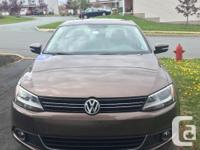 Make Volkswagen Model Jetta Year 2013 Colour Brown kms